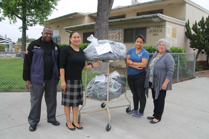 HGNNC delivers backpacks to schools