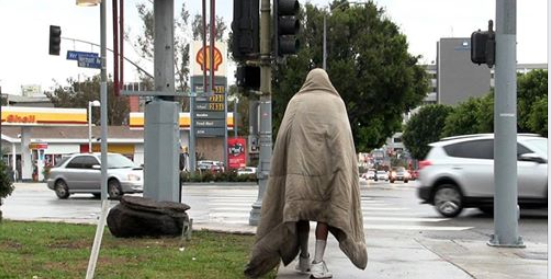 Homeless man walking away